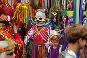 The Society of Saint Anne gathering to parade during Mardi Gras on 25th February 2020 in Bywater district of New Orleans, Louisiana, United States. Mardi Gras is the biggest celebration the city of New Orleans hosts every year. The magnificent, costumed, beaded and feathered party is laced with tradition and  having a good time. Celebrations are concentrated for about two weeks before and culminate on Fat Tuesday the day before Ash Wednesday and Lent.