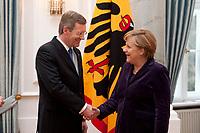13 JAN 2011, BERLIN/GERMANY:<br /> Christian Wulff (L), Bundespraesident, und Angela Merkel (R), CDU, Bundeskanzlerin, Neujahrsempfang des Bundespraesidenten, Schloss Bellevue<br /> IMAGE: 20110113-01-080<br /> KEYWORDS: Bundespräsident, Handshake