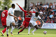 Wilfried Bony of Swansea city ® holds off Etienne Capoue of Watford. Premier league match, Swansea city v Watford at the Liberty Stadium in Swansea, South Wales on Saturday 23rd September 2017.<br /> pic by  Andrew Orchard, Andrew Orchard sports photography.