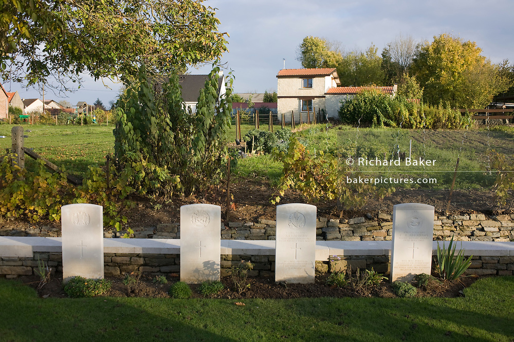 Farm land and head stones of British and Commonwealth soldiers killed in final stages of WW1 at Vis-en-Artois war grave cemetery