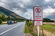 "Regarding the ""NO FREEDOM CAMPING ZONE"" sign: Freedom camping in New Zealand is when you camp on public land that isn't a recognized camping ground. You can only camp in designated Freedom Camping Zones if you are certified self-contained. From Makarora, Wilkin River Jets carried us 3km via jetboat up the Makarora River to Young River confluence to begin tramping the Gillespie Pass Circuit, in Mount Aspiring National Park, Southern Alps, Otago region, South Island of New Zealand. After 4 days, they picked us up at Kerin Forks on Wilkin River."