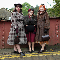 © Licensed to London News Pictures. <br /> 16/10/2016. <br /> Goathland, UK.  <br /> <br /> Women wearing 1940's period clothing stand on the bridge at Goathland station during the final day of the North Yorkshire Moors Railway Wartime Weekend event. <br /> The annual event brings together re-enactors and enthusiasts along the length of the NYMR heritage steam railway line to recreate the feel of the war years of the 1940's. <br /> <br /> Photo credit: Ian Forsyth/LNP