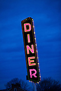 Neon diner sign against a blue sky  in Gordonville, PA.