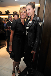 Left to right, YASMIN LE BON and her daughter AMBER LE BON at a reception hosted by Vogue and Burberry to celebrate the launch of Fashions Night Out - held at Burberry, 21-23 Bond Street, London on 10th September 2009.
