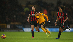 Wolverhampton Wanderers' Helder Costa (centre) and Bournemouth's Charlie Daniels (left) battle for the ball