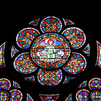 Europe, France, Paris. Stained glass windows of Notre-Dame Cathedral.