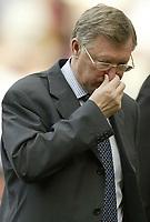 Photo Aidan Ellis.<br />Manchester United v Liverpool.<br />FA Barclaycard Premiership.<br />24/04/2004.<br />Manchester's Alex Ferguson contemplates losing at home to rivals Liverpool