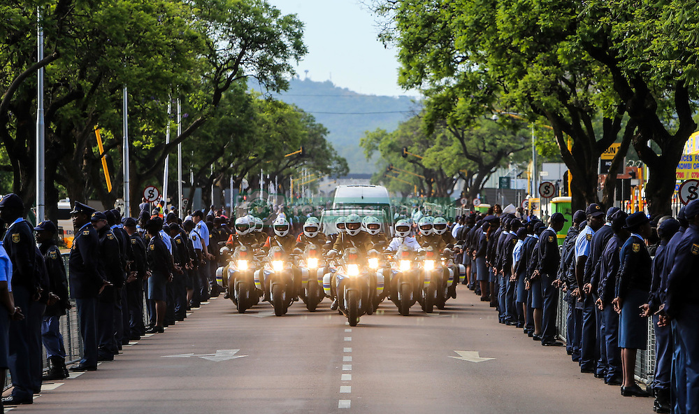 PRETORIA, Dec. 12, 2013  The funeral procession with the hearse carrying the body of Nelson Mandela makes its way towards the Union Buildings in Pretoria, South Africa, Dec. 12, 2013. The memorial event in the Union Buildings would last for three days before the Mandela funeral is to be held at his home village of Qunu in the southern province of the Eastern Cape on Sunday. (Credit Image: © Meng Chenguang/Xinhua/ZUMAPRESS.com)