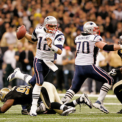 2009 November 30: New England Patriots quarterback Tom Brady (12) scrambles away from New Orleans Saints defensive end Will Smith (91) during a 38-17 win by the New Orleans Saints over the New England Patriots at the Louisiana Superdome in New Orleans, Louisiana.