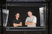 Tyler Morrison and photographer John Krause pose for a headshot in the 13,000-sq.-ft. building that is the future home of Liquid Sound Studios, Thursday, July 26, 2012, on Corydon Pike in New Albany, Ind. (Photo by Brian Bohannon)