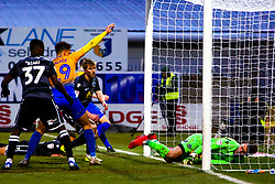 Kieran O'Hara of Macclesfield Town's attempt to keep out a shot from Tyler Walker of Mansfield Town is unsuccessful putting Mansfield Town 3-1 up - Mandatory by-line: Ryan Crockett/JMP - 02/02/2019 - FOOTBALL - One Call Stadium - Mansfield, England - Mansfield Town v Macclesfield Town - Sky Bet League Two