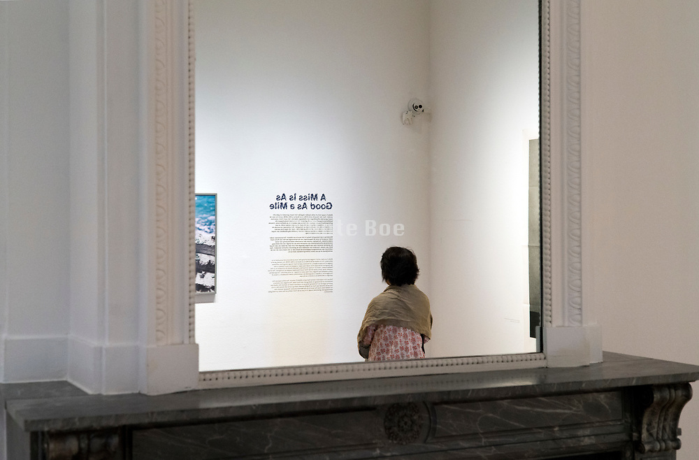 person reading an informative wall text in FOAM Museum Amsterdam Netherlands