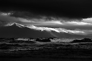 Huge seas (for Aberffraw, rolled right up to the top of this long flat beach, whilst breakers of cloud rolled over the stormy peaks of the Welsh mountains of the Llyn Peninsula in the background.<br />