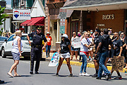 Watsontown, PA (June 28, 2020) -- Black Lives Matter protesters (right) clash with a a counter-protester in the middle of Main Street.