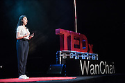 Megan Lam speaks on stage during the TEDxWanChai event Emergence on Jun 2, 2018, in Hong Kong. / Moses Ng / MozImages