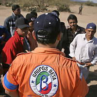 A Grupo Beta border patrol agent documents a van load of migrants preparing to cross the border into the US near Sabado, Mexico. Group Beta, formerly a branch of the Mexican State Police, is now an independent organization offering aid and advice to those wishing to cross over, focused mainly on discouraging the practice, and weed out dangerous human trafficking smugglers.