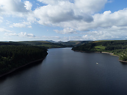 © Licensed to London News Pictures. 11/08/2021. Merthyr Tydfil, UK. Aerial view of the reservoir towards the Brecon Beacons, during today's sunshine. Mixed weather with sunshine for some and heavy showers in other areas. Photo credit: Andrew Bartlett/LNP