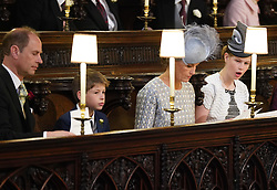 The Earl and Countess of Wessex and their children Lady Louise Windsor and James, Viscount Severn sitting in St George's Chapel at Windsor Castle ahead of the wedding of Prince Harry and Meghan Markle.