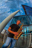 Saxophonist Nelson Rangell on the Millennium Bridge, Downtown Denver, Colorado USA.