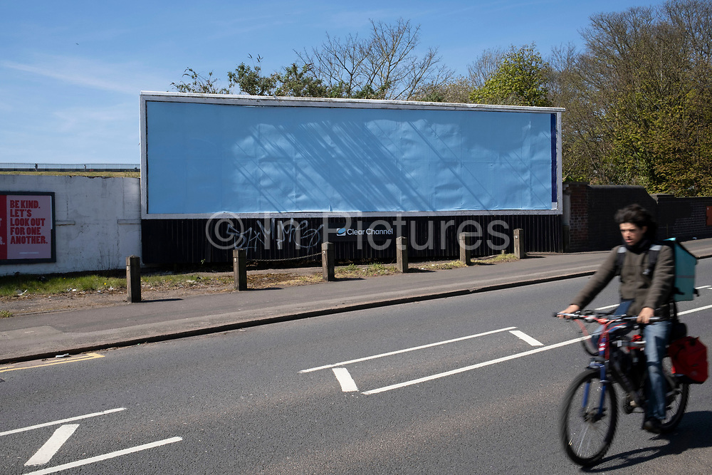 Empty / blank billboards due to a lack of advertising spend have become a common sight under lockdown as seen here in Ladywood on 15th April 2020 in Birmingham, England, United Kingdom. Coronavirus or Covid-19 is a new respiratory illness that has not previously been seen in humans. While much or Europe has been placed into lockdown, the UK government has put in place more stringent rules as part of their long term strategy, and in particular social distancing.