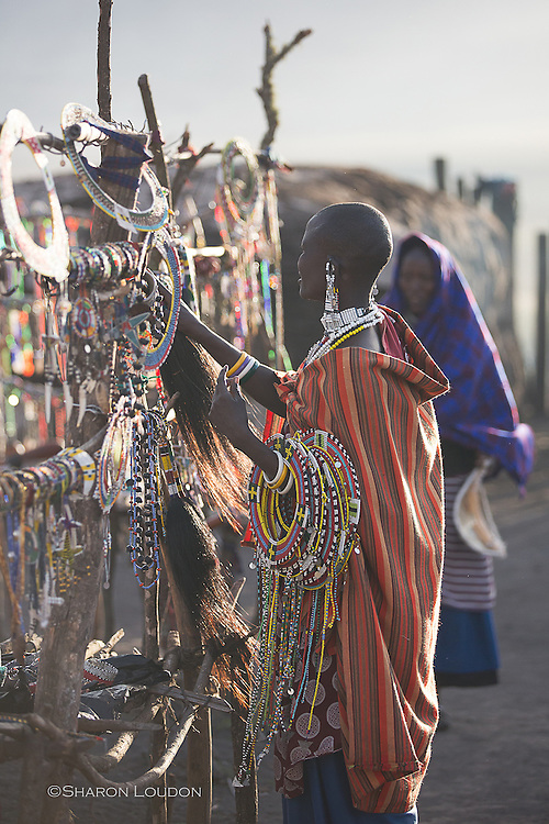 Smoke from the boma adds drama to this backlit image of a Massai woman bringing in beadwork for the evening