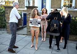 © Licensed to London News Pictures. 10/10/2016. London, UK. PETA activists are blocked as they demonstrate against the use of wool at the opening event of Wool Week. The demonstrators were nearly nude and covered in fake blood to protest against the alleged use of cruelty in the wool industry. Photo credit : Tom Nicholson/LNP