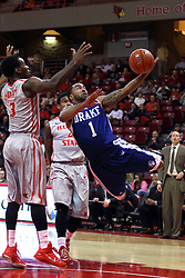 07 January 2015:   Karl Madison attempts a sideways leap shot after passing Bobby Hunter and encountering Daishon Knight during an NCAA MVC (Missouri Valley Conference) men's basketball game between the Drake Bulldogs and the Illinois State Redbirds at Redbird Arena in Normal Illinois.  Illinois State comes out victorious 81-45.