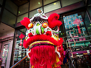 05 FEBRUARY 2019 - BANGKOK, THAILAND:  A Lion dancer leaves a jewelry shop in Bangkok after performing in the shop for Chinese New Year. Chinese New Year celebrations in Bangkok started on February 4, 2019, although the city's official celebration is February 5 - 6. The coming year will be the Year of the Pig in the Chinese zodiac. About 14% of Thais are of Chinese ancestry and Lunar New Year, also called Chinese New Year or Tet is widely celebrated in Chinese communities in Thailand.     PHOTO BY JACK KURTZ