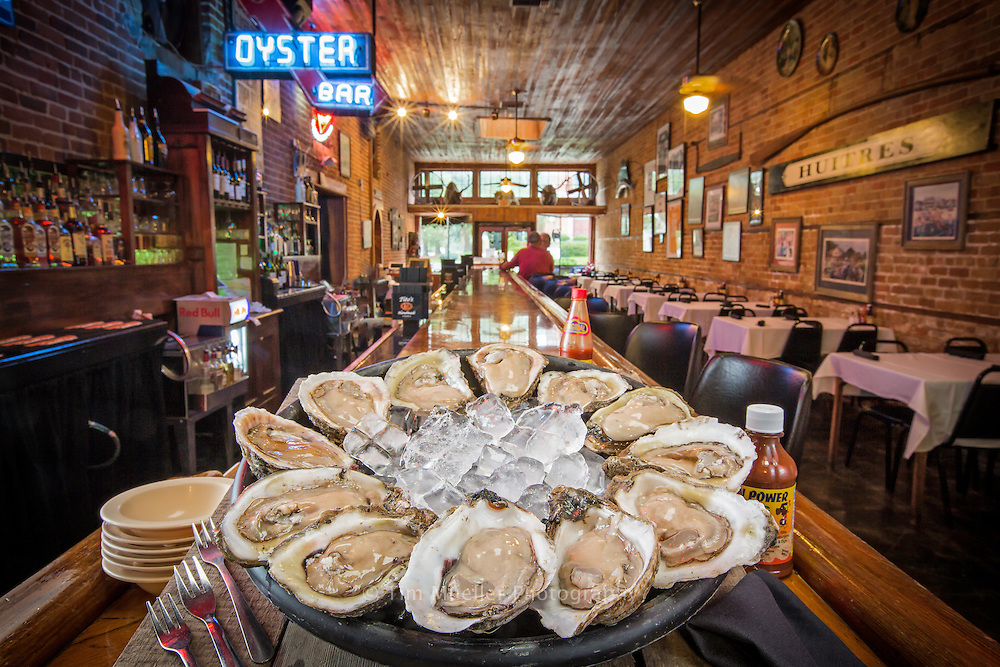A dozen fresh oysters grace the bar at Black's Oyster Bar and Seafood located at 319 Pere Megret St. in Abbeville, Louisiana.