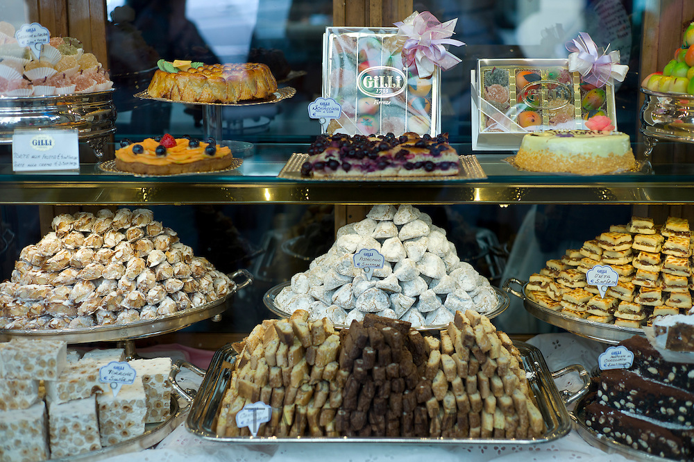 Cakes and pastries in shop window of luxury patticeria, caffe sweet shop Gilli, established in 1733 in Florence, Tuscany, Italy