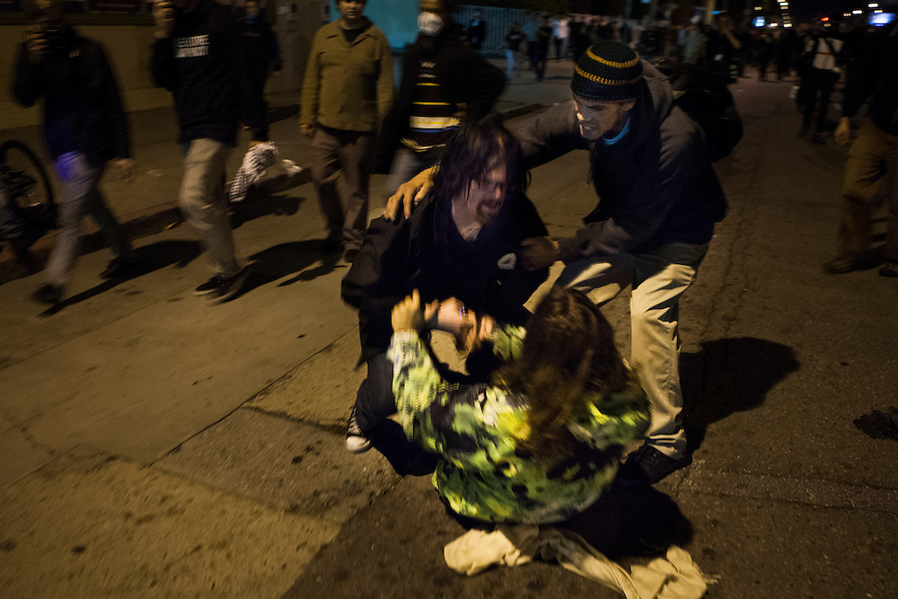 OAKLAND, CA - OCTOBER 26, 2011: Two men get into a scuffle after one accuses the other of being an undercover police officer. The Occupy Oakland movement, like many others has been criticized for having no clear goal, leader, or uniformity.