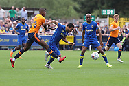 AFC Wimbledon striker Andy Barcham (17) battles for possession with Oldham Athletic midfielder Ousmane Fane (24) during the EFL Sky Bet League 1 match between AFC Wimbledon and Oldham Athletic at the Cherry Red Records Stadium, Kingston, England on 21 April 2018. Picture by Matthew Redman.