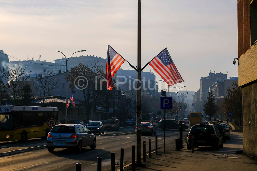 US flags fly on the street George Bush Boulevard Xhorxh Bush on the 13th of December 2018, in Pristina, the capital and largest city of Kosovo, it has a mainly Albanian population along with other smaller communities.  The street was named in honour of the US president to show appreciation for the military support received from the US during the Kosovo war with Yugoslavia.