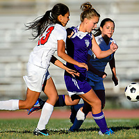 092513  Adron Gardner/Independent<br /> <br /> Grants Pirates Rita Sarracino (13), left, and Randee Romero (15), right, attempt to squeeze Miyamura Patriot Natalie DePauli (1) on a drive in Grants Wednesday.