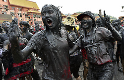 April 30, 2017 - Cangyuan County, Yunnan, China - People of the Wa ethnic group and tourists take part in the ''Monihei'' Carnival in southwest China. As a tradition, Wa people throw and smear muddy water onto each other to express their wishes for health and happiness during the ''Monihei'' carnival. (Credit Image: © Chen Haining/Xinhua via ZUMA Wire)