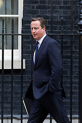 "© Licensed to London News Pictures. 29/08/2013. London, UK. David Cameron, the British Prime Minister, leaves a meeting of the his cabinet on Downing Street in London today (29/08/2013) as he heads for a recalled British Parliament preparing to debate the possibility of ""direct"" military action over recent reports an alleged chemical weapons attack in Syria. Photo credit: Matt Cetti-Roberts/LNP"