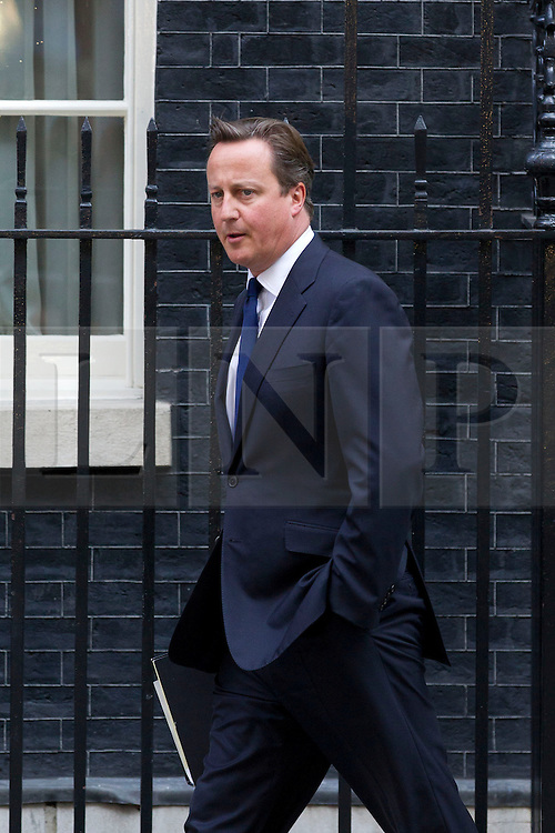 """© Licensed to London News Pictures. 29/08/2013. London, UK. David Cameron, the British Prime Minister, leaves a meeting of the his cabinet on Downing Street in London today (29/08/2013) as he heads for a recalled British Parliament preparing to debate the possibility of """"direct"""" military action over recent reports an alleged chemical weapons attack in Syria. Photo credit: Matt Cetti-Roberts/LNP"""