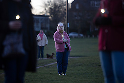 © Licensed to London News Pictures. 13/03/2021. London, UK. Members of the public use their phone torches as they attend a vigil for Sarah Everards on Blackheath Common in South East London. Vigils are being held across the country following her death. Serving police officer Wayne Couzens has been charged with kidnap and murder.  Photo credit: George Cracknell Wright/LNP