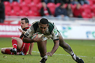 Chris Hala'ufia of London Irish dives over to score a try. Heineken cup rugby, Scarlets v London Irish at the Parc y Scarlets stadium in Llanelli on Sunday 17th Jan 2010.  pic by  Andrew Orchard  , Andrew Orchard sports photography,