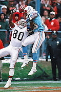 Cleveland Browns wide receiver Andre Rison (80) tries to catch an end zone pass broken up by leaping Houston Oilers cornerback Chris Dishman (28) during the NFL football game against the Houston Oilers on Nov. 5, 1995 in Cleveland. The Oilers won the game 37-10. (©Paul Anthony Spinelli)