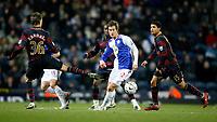 Photo: Paul Greenwood/Sportsbeat Images.<br />Blackburn Rovers v Arsenal. Carling Cup, Quarter Final. 18/12/2007.<br />Blackburn's Morten Gamst Pedersen (C) evades the flying leg of Mark Randall