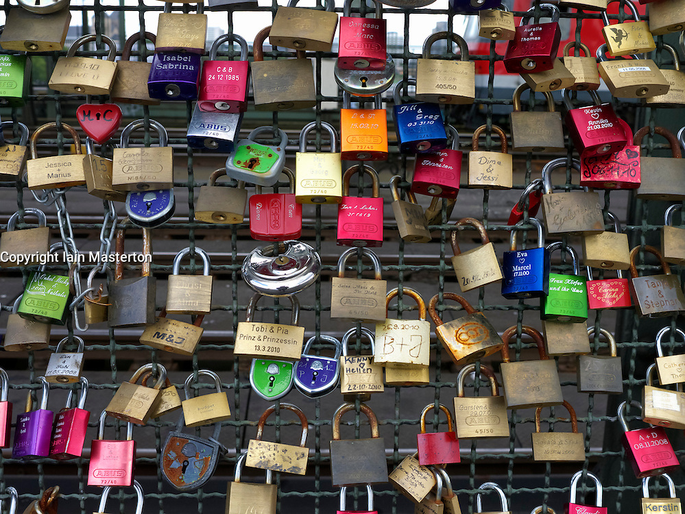 Detail of locks attached to Hohenzollern Bridge by lovers in Cologne Germany