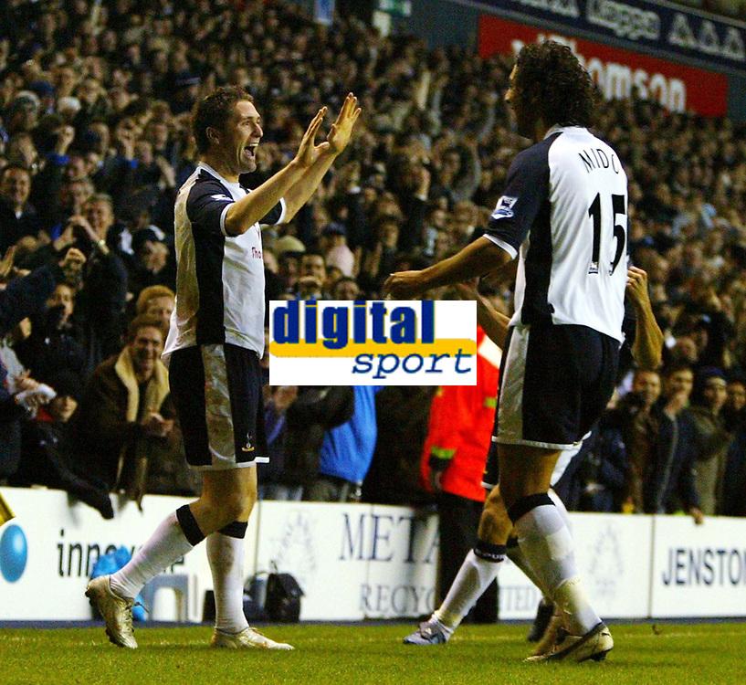 Photo: Chris Ratcliffe.<br />Tottenham Hotspur v Sunderland. The Barclays Premiership. 03/12/2005.<br />Robbie Keane (L) celebrates his goal with Mido