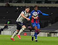 Football - 2020 / 2021 Premier League - Tottenham Hotspur vs Crystal Palace - Tottenham Hotspur Stadium<br /> <br /> Matt Doherty of Tottenham and Wilfried Zaha <br /> <br /> Credit : COLORSPORT/ANDREW COWIE