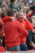 Liverpool fans celebrate Philippe Coutinho of Liverpool's  first goal for the team to make it 1-0. The FA Cup, semi final match, Aston Villa v Liverpool at Wembley Stadium in London on Sunday 19th April 2015.<br /> pic by John Patrick Fletcher, Andrew Orchard sports photography.
