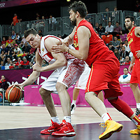 04 August 2012: Russia Alexey Shved posts up Spain Marc Gasol during 77-74 Team Russia victory over Team Spain, during the men's basketball preliminary, at the Basketball Arena, in London, Great Britain.