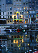 France, Normandy.  Honfleur,  Old harbour at night.