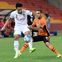 BRISBANE, AUSTRALIA - FEBRUARY 21: Peerapat Notchaiya of Muangthong United controls the ball in front of Jack Hingert of the Roar during the Asian Champions League Group Stage match between the Brisbane Roar and Muangthong United FC at Suncorp Stadium on February 21, 2017 in Brisbane, Australia. (Photo by Patrick Kearney/Brisbane Roar)