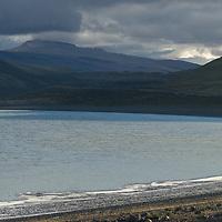 Saline deposits encircle the shores of Laguna Amarga, near Torres del Paine National Park, Chile.