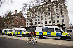 © Licensed to London News Pictures. 14/03/2021. London, UK. Police vans are parked outside New Scotland Yard ahead of a protest against the Police, Crime, Sentencing and Courts Bill 2021. This demonstration comes after police arrested attendees at a vigil for Sarah Everard on Clapham Common last night.  Photo credit: George Cracknell Wright/LNP